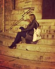 Me sitting on the Midnight in Paris steps in Paris