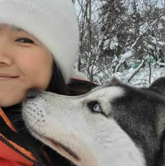 Me and one of the huskies from my dog sled team