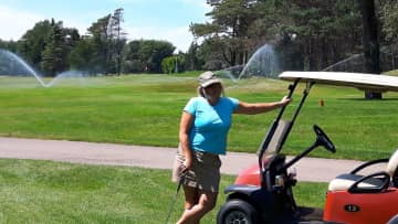 Margaret playing a round of golf at our local course, the Digby Pines Golf Resort and Spa