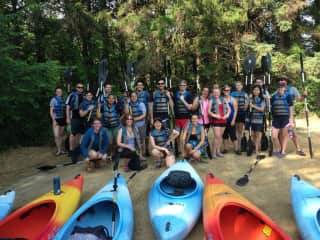 leading a group of students on kayaking trip