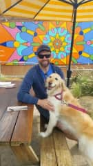 Bill with sweet Shanti, the Golden Retriever who loves belly rubs and being out on the town