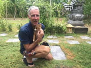 James with one of the house puppies in Indonesia