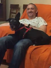 This is my husband with Blacky at our house (he sometimes pays a visit too).