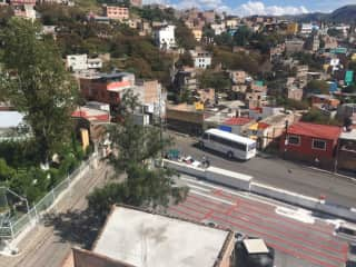 This is a view from the 5th floor terrace. In the lower righthand corner is the top of an OXXO convenience store building. The little tiendas on the street down below sell everything from fruits and vegetables to paper supplies and flowers. The