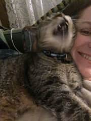 Me and our cat (we rescued him in 2006 when he was already full grown, and he lived a happy life with us till 2018