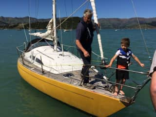 Brian with one of our wee grandies Cole. Brian's passion is sailing!