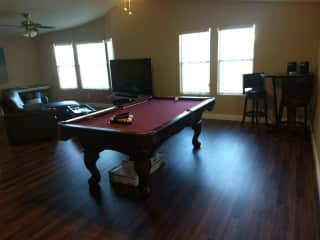 What could be considered a living room is all opened with the family room. We have a pool table not quite to regulation size and additional bar stools and table in the corner. The TV is only hooked up to the internet.