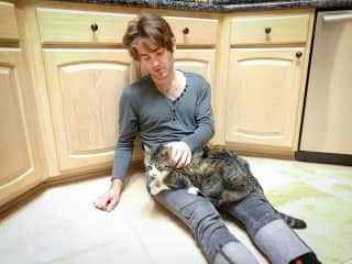 Nash with friend's cat at her home in Texas.