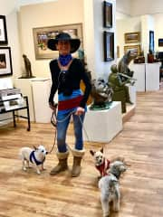 Pamela and the Tres Amigos walking in an art gallery