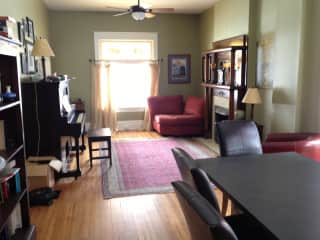 Main floor front sitting area with gas fireplace
