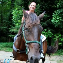 Pamela riding in the Tennessee mountains
