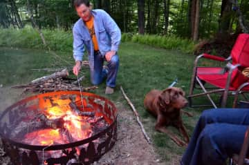 Pete with Molly enjoying campfire in back yard
