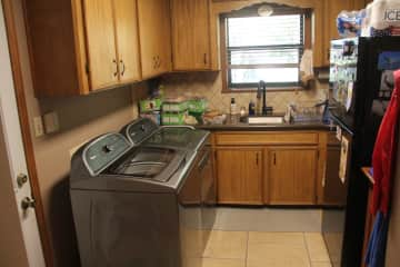 Large utility room with extra frig.