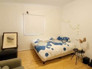Bedroom. Includes wardrobe with shelving. Door opens onto family room.