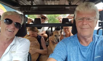 Christoph and Elly return home to two happy dogs. Taboga, Panama.