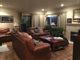 Our living room & sliding glass doors lead out to backyard patio