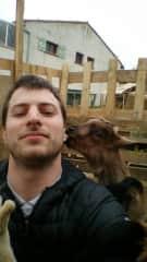 Michael with his grandparent's goat Bikette