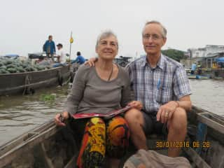 Maxien and Craig at the morning floating market on the Mekong Delta in Vietnam.  2016