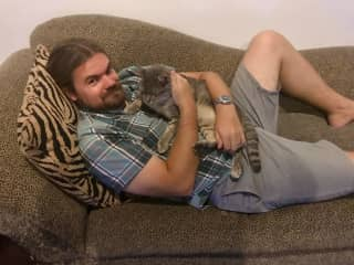 Ryan with Genghis, an awesome cat we got to sit for in Thailand