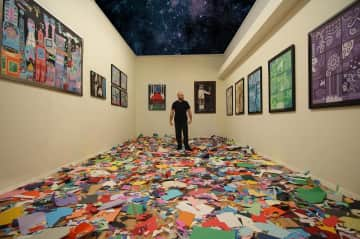 This is me in a room filled with my artwork :) I created all using a regular scissor and paper