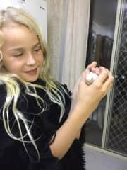 Talara holding a young budgie