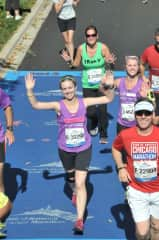 Running is one of my hobbies!  Here I am completing the Chicago Marathon in 2013.