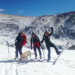 Friends backcountry skiing and dog sitting