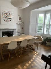 Our dining room with piano hidden on the right for music lovers