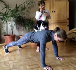 My daughter Josephine and I doing one of my favorite exercises with my favorite cat on my back