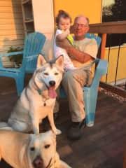 Tim sitting with Shelby, Husky Dog