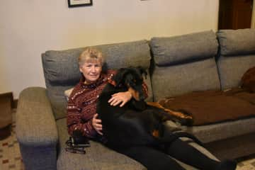 Vicki with Misha the loveable Doberman....she just loved her cuddles.