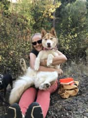 Me with my daughter's Husky Cona. She loves hikes and cuddles! My chihuahua Sparkles looks a little jealous.