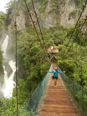 Sarah hiking past Ecuadorian waterfalls