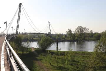 This is a foot bridge over the river Elbe - it's close to a lovely park and can be reached by bike via a cycle path (about 30 minutes) or public transport