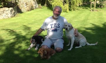 Robin with three happy dogs in Yorkshire