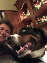 Me with my parents' dog this past Christmas. Bronco is the best Bernese Mountain dog ever!