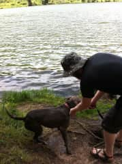 Derek leashing up Breezy after a frolic in the lake, from a house sit in Colorado