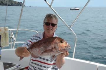 Mike doing what he loves most - fishing and sailing