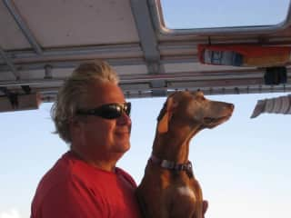 Captain Mike with Belle Toujours, our Vizsla, who crossed the Rainbow Bridge.