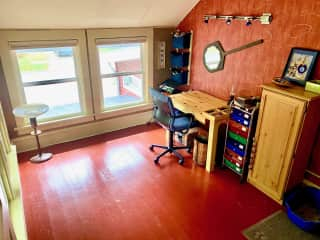 This is my craft room, on it's on level above the garage. I love it! Bags for the kitty litter and litter itself is in the top left shelf.