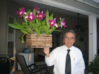 Bill with one of his orchids in bloom