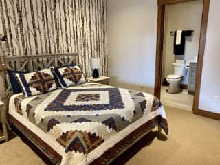 Comfy guest bedroom with Queen size bed.