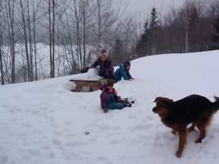 The grandkids and Penny at Grandmas cabin when the snow comes!  Penny loves the place!