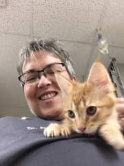 Me with a kitten at work