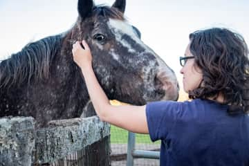 Katie with a horse at a farm in Florida.
