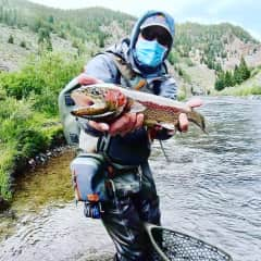 Fly fishing 2020 near our place in Crested Butte. (Tom put the mask on fast because the other fisherman, taking the picture, was a very old guy and because Tom is simply that nice. As well as, ER docs, well... they love PPE)