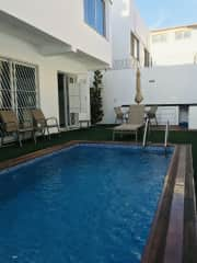 Patio and pool, pool cleaner comes once a week.  House has guard outside and secure doors and windows.