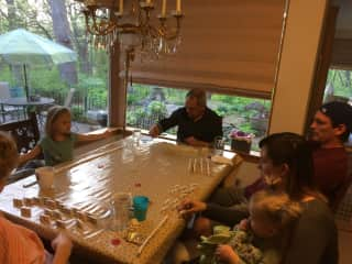 All of us playing dominoes Saturday nights