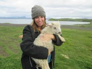 Playing with and tending to lambs in Iceland at my B&B, where I stayed a month.