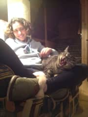 Toby getting in a big yawn while relaxing on Lauren's lap. This was during our house-sit in Valdez, Alaska.